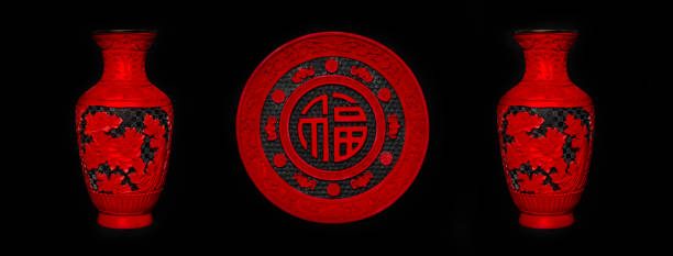 A set of 3 lacquer ware home decoration in rich red and black. Plate in the middle, with the Chinese character 'Fu' which means good luck and wealth.