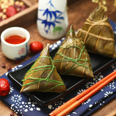 Chinese dragon boat festival rice dumplings zongzi and wine on black plate